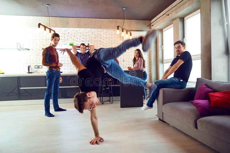 Friends dance fun at a student`s party in the apartment.  stock photos