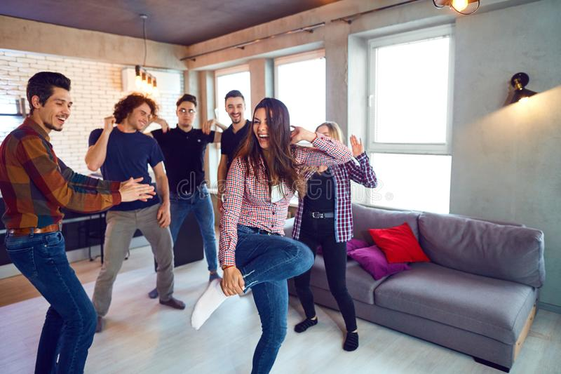 Friends dance fun at a student`s party in the apartment.  royalty free stock images