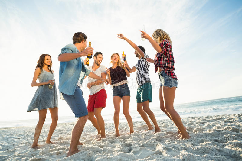 Friends dancing on the beach stock photos