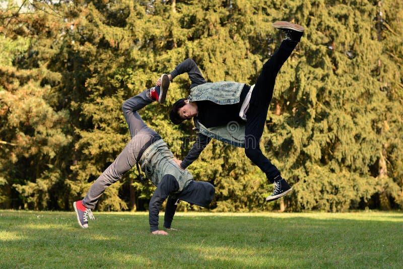Friends dancing break dance on the park. Friends dancing break dance in the park stock photography