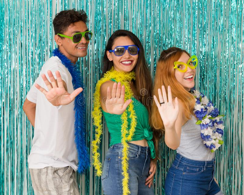 Friends do dance choreography. Stop. Get ready. Funny friends do dance choreography. People wearing carnival costumes gesticulate present the palm of their hand royalty free stock photos