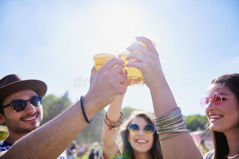 Friends drinking beer and having fun in festival. Friends drinking beer and having fun at the summer festival royalty free stock images