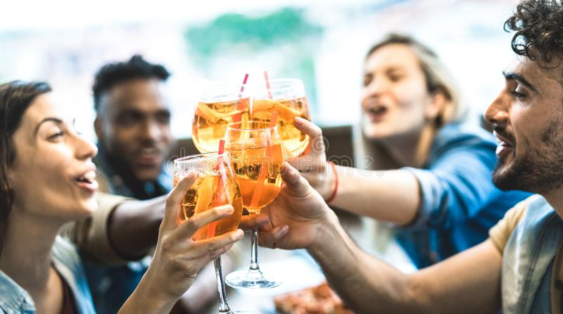 Friends drinking spritz at fashion cocktail bar restaurant - Friendship concept with young people having fun together stock image