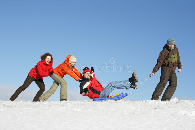 Friends drive in a sledge royalty free stock photography