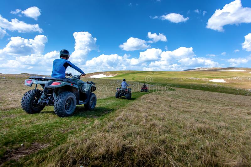Friends driving off-road with quad bike or ATV and UTV vehicles.  royalty free stock photos