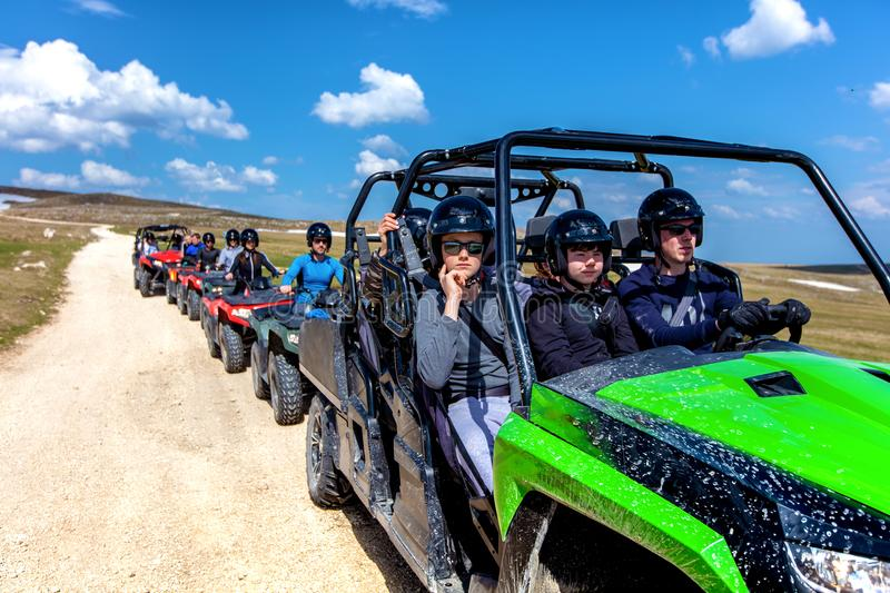 Friends driving off-road with quad bike or ATV and UTV vehicles.  royalty free stock image