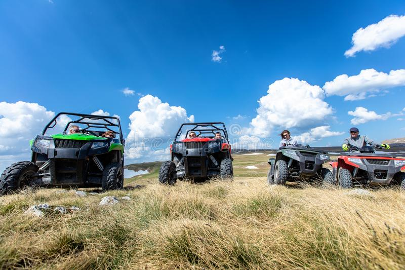 Friends driving off-road with quad bike or ATV and UTV vehicles.  royalty free stock photo