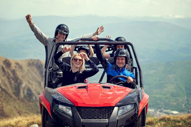 Friends driving off-road with quad bike or ATV and UTV vehicles.  stock photography