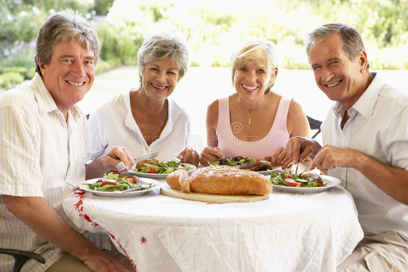 Friends Eating An Al Fresco Lunch Royalty Free Stock Images
