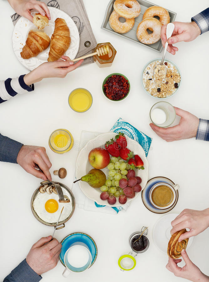 Friends eating breakfast stock photography