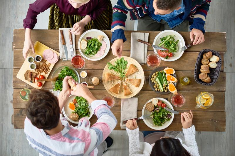 Friends Eating at Dinner Table stock photo
