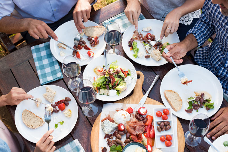 Friends eating together royalty free stock images