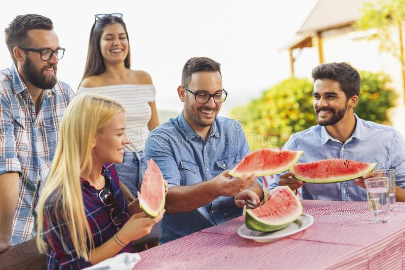 Friends eating watermelon royalty free stock photography