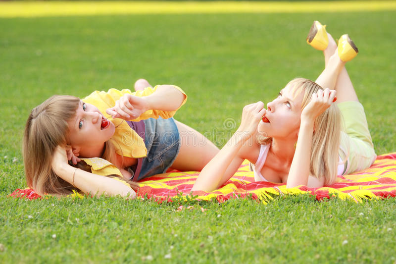 Download Friends Eats Cherries In Park Stock Photo - Image: 11270750