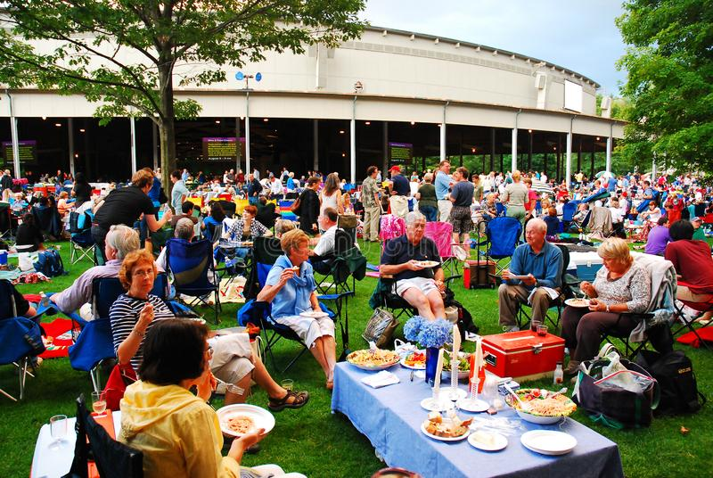 Dinner at the Tanglewood Theater. Friends enjoy an al fresco dinner at the Tanglewood Theater in the Berkshire Mountains of Massachusetts royalty free stock photo