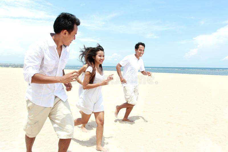 Friends Enjoying Beach Together stock images