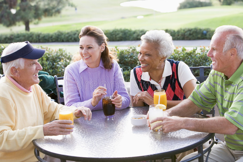 Download Friends Enjoying A Beverage By A Golf Course Stock Image - Image: 7230851