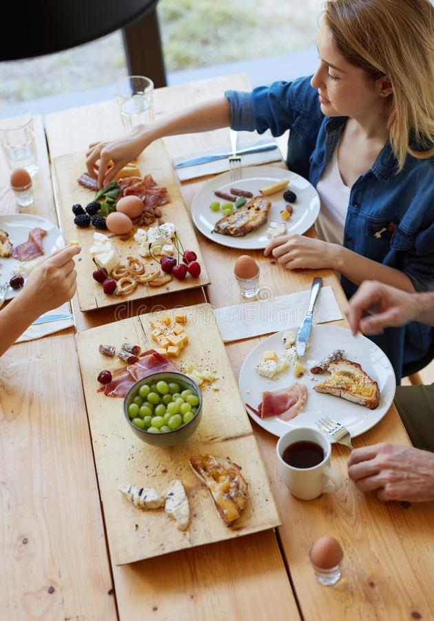 Friends enjoying breakfast together royalty free stock images