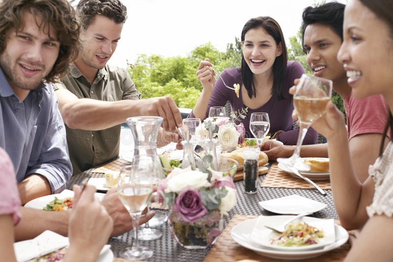 Friends Enjoying Dinner Party Outdoors royalty free stock photography