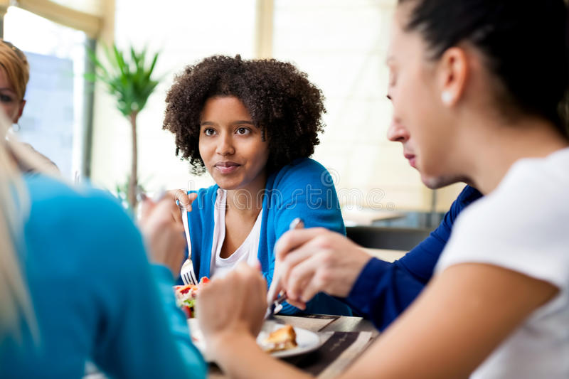 Friends enjoying dinner at a restaurant royalty free stock photo