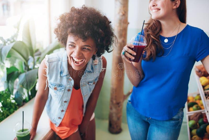 Friends enjoying a juice bar. royalty free stock photo
