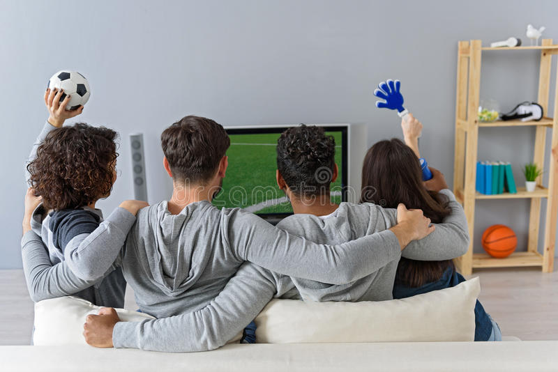 Friends enjoying soccer in TV royalty free stock image