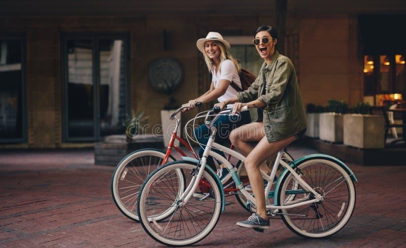 Friends enjoying their bike ride stock images