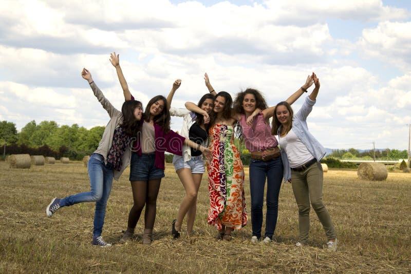 Friends enjoying themselves in a field.