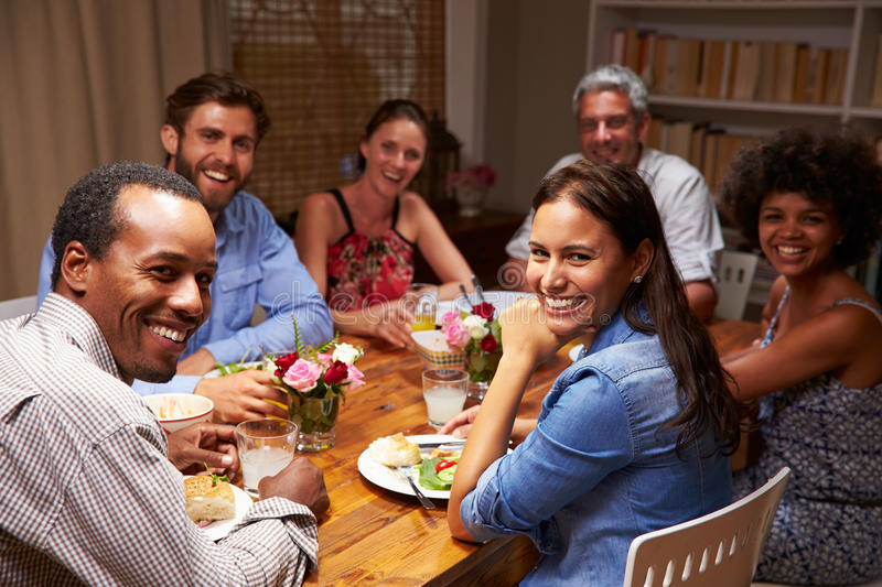 Friends at an evening dinner party, looking at camera royalty free stock photos