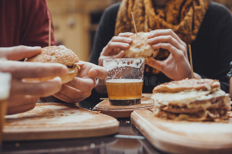 Friends In Fast Food Restaurant royalty free stock photos