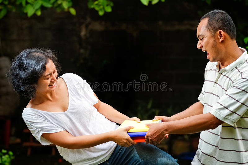 Download Friends fight for books stock image. Image of friends - 23982983