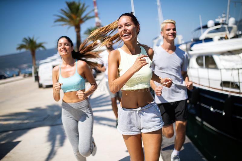 Friends running fitness training together outdoors living active healthy royalty free stock images