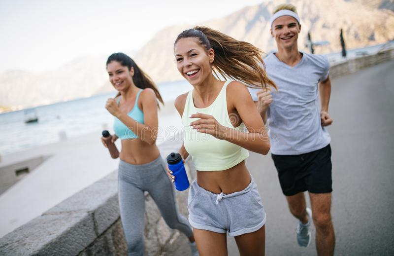 Friends fitness training together outdoors living active healthy stock photos