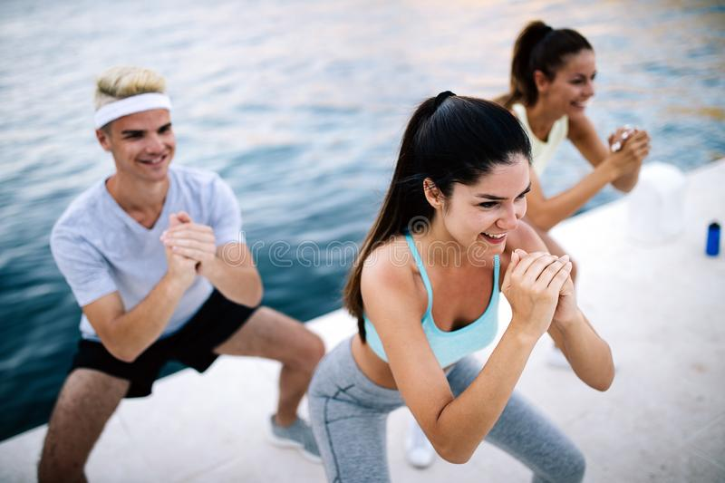 Friends fitness training together outdoors living active healthy royalty free stock images