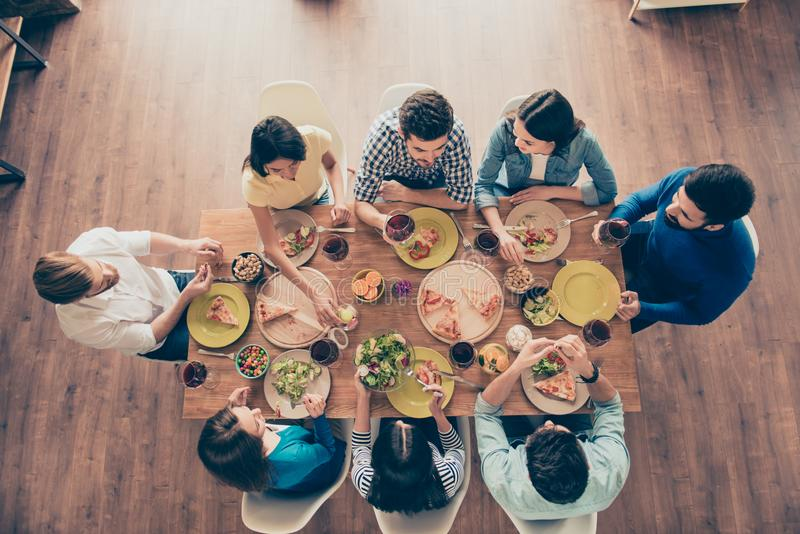 Friends forever! Top view of group of young people, who are having fun at home on the party with tasty food, drinks, jokes, enjoy royalty free stock photography