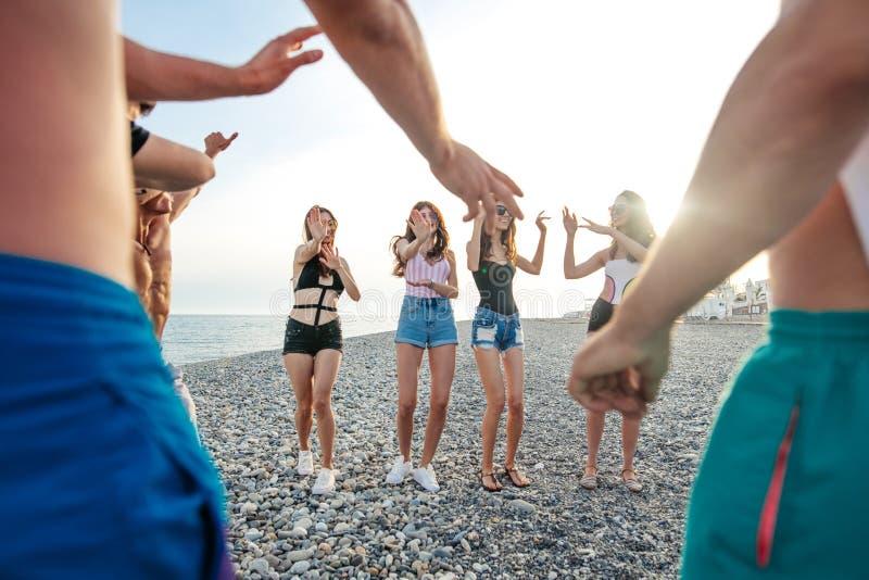Friends dance on beach under sunset sunlight, having fun, happy, enjoy. Friends funny dance on beach under sunset sunlight, having fun, happy, enjoy royalty free stock image