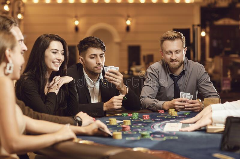 Friends gamble poker roulette in a casino.  stock photography