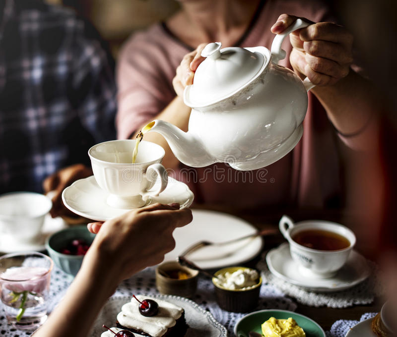 Friends Gathering Together on Tea Party Eating Cakes Enjoyment h. Appiness stock photography
