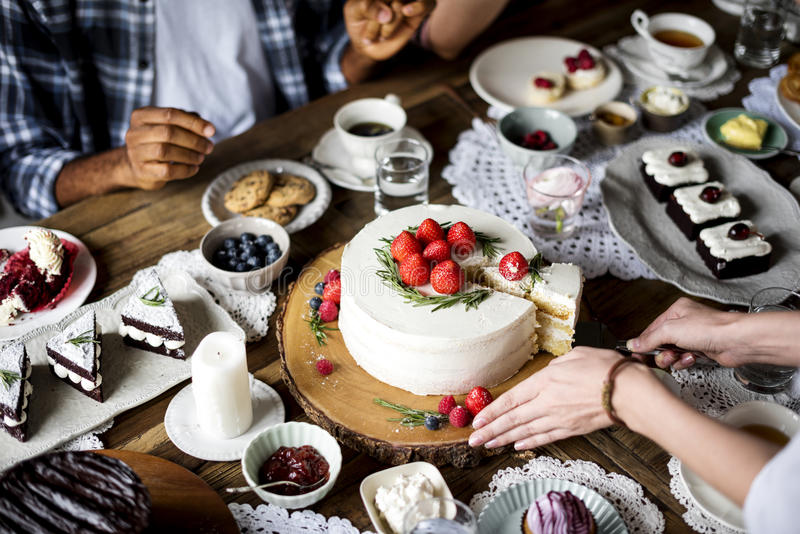 Friends Gathering Together on Tea Party Eating Cakes Enjoyment h. Appiness stock images