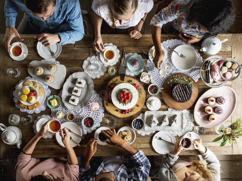 Friends Gathering Together on Tea Party Eating Cakes Enjoyment h. Appiness stock image