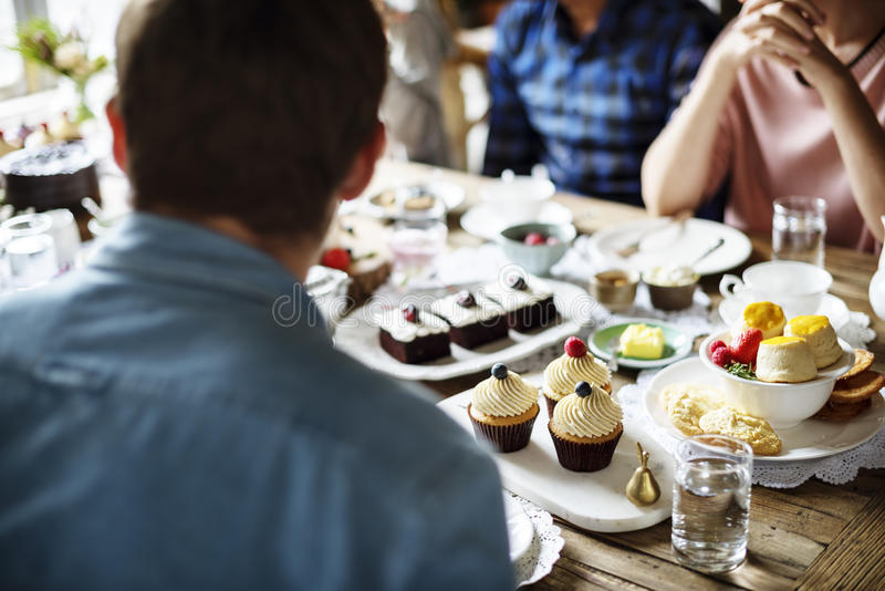 Friends Gathering Together on Tea Party Eating Cakes Enjoyment h. Appiness royalty free stock images