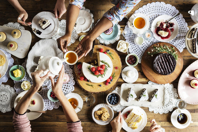 Friends Gathering Together on Tea Party Eating Cakes Enjoyment h. Appiness stock photo