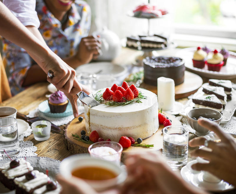 Friends Gathering Together on Tea Party Eating Cakes Enjoyment h. Appiness royalty free stock photo