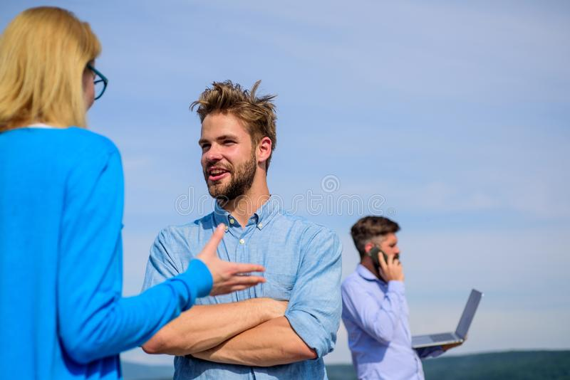 Friends glad to see each other. Face to face conversation advantages concept. Couple happy flirting while man tense with. Friends glad to see each other. Face to royalty free stock photo