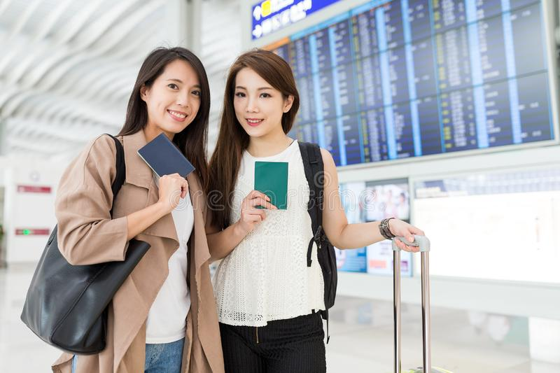 Friends go travel together at Hong Kong international airport. Beautiful young asian woman royalty free stock photo