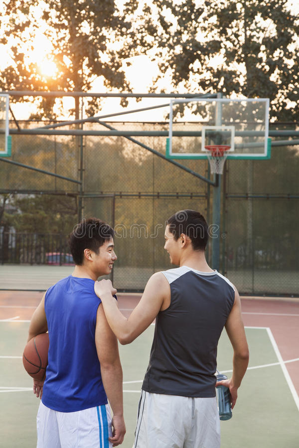 Friends going back home after basketball game royalty free stock photos