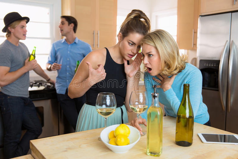 Friends gossiping passing secrets and whispering about embarrassing shocking dating stories royalty free stock image