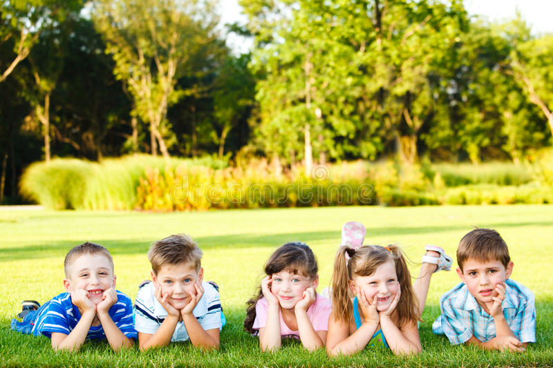 Friends on grass royalty free stock image