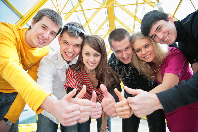Friends group gesturing ok stock images