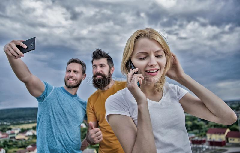 Friends group speaking by smart phone outdoor. Close up of a gro royalty free stock photography
